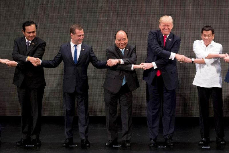 trump-in-asia-tour-hand-shaking-2017-photo