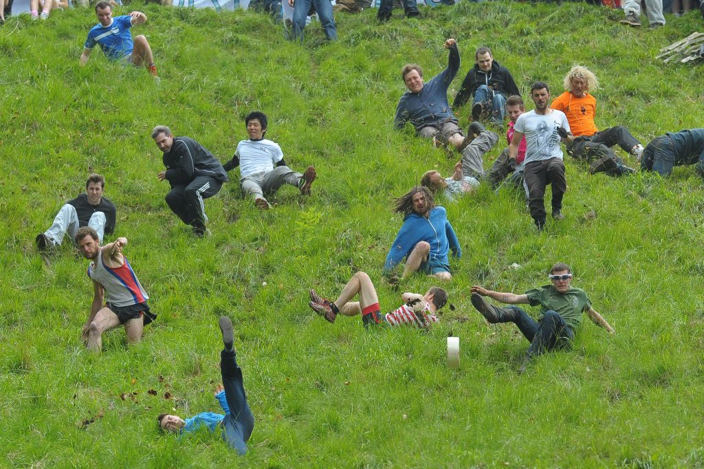 Cooper's Hill Cheese-Rolling 2018: See Crazy Pictures of People Falling Down The Hill Chasing The Cheese in England + Happy New Record-Breaker