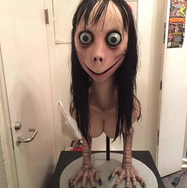 momo-challenge-doll-face-creepy-story-photo