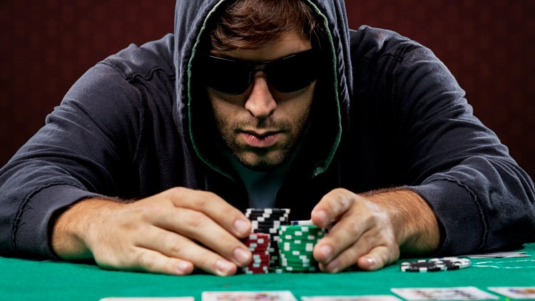 man-playing-poker-photo