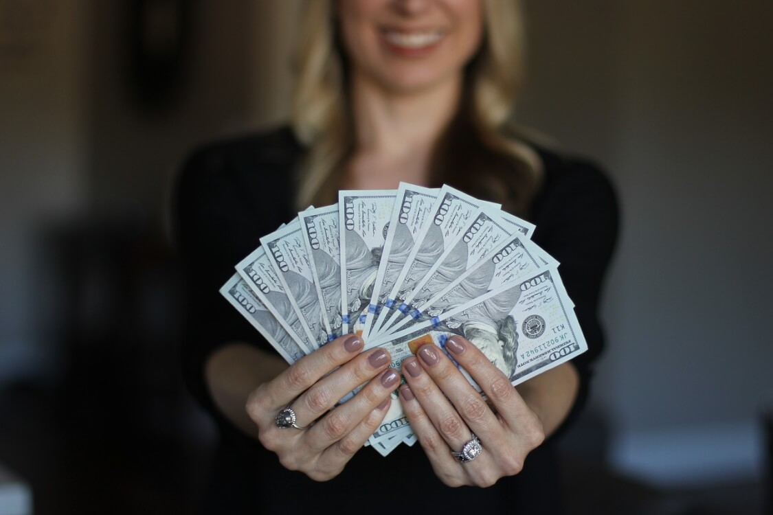 woman-holding-money-pic
