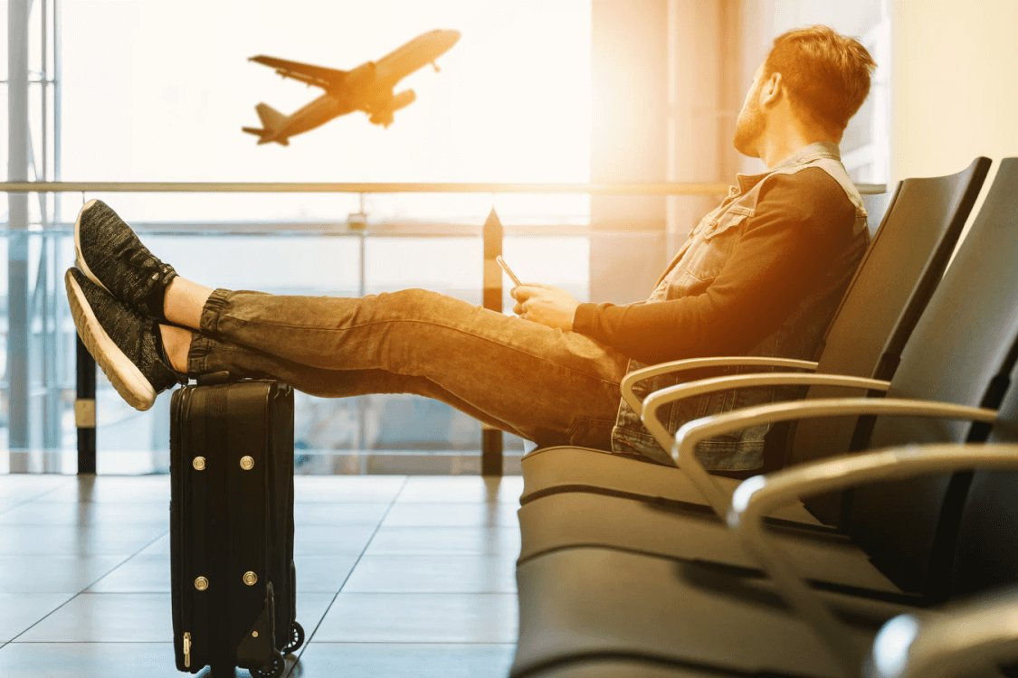 man-waiting-at-airport-photo