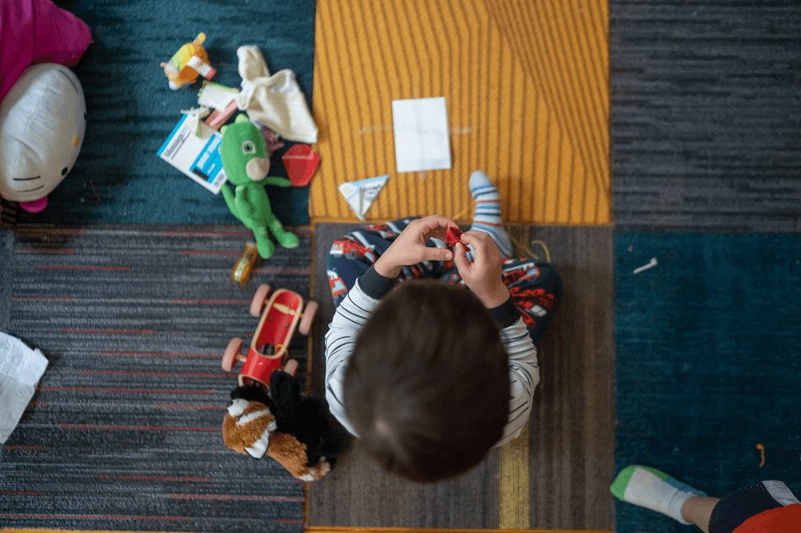 toddler-playing-with-toy-photo