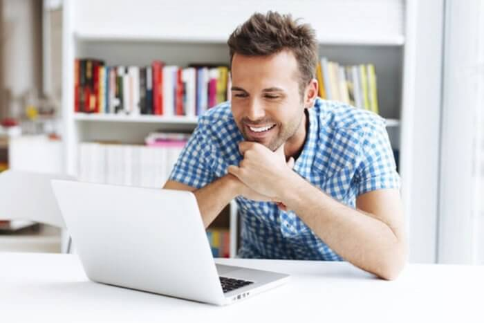 young-man-looking-at-laptop