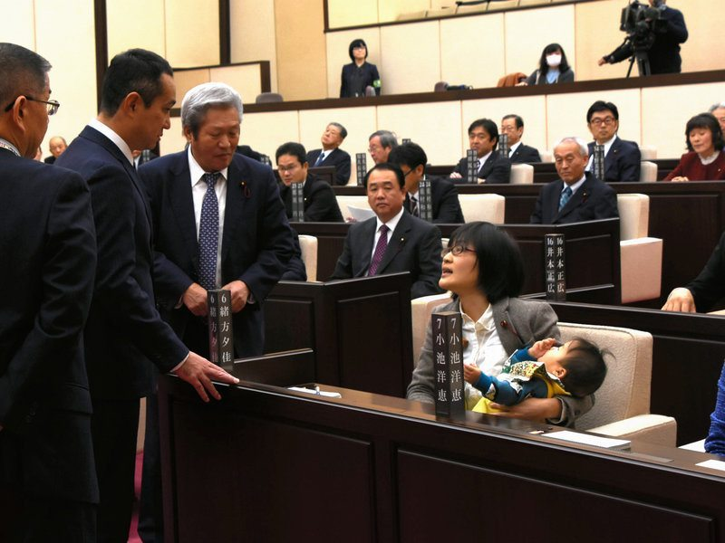 japanese-politician-baby-banned-floor-photo